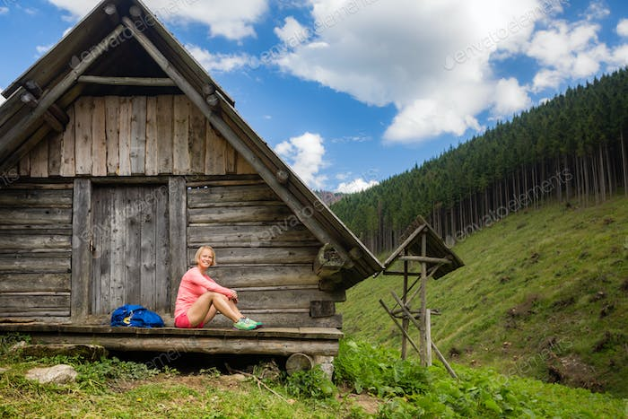 Woman hiking and camping in inspiring mountain landscape
