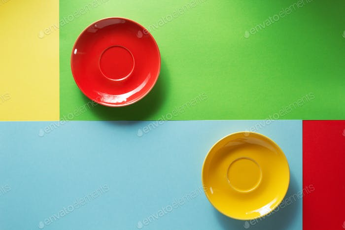 empty saucer at abstract colorful