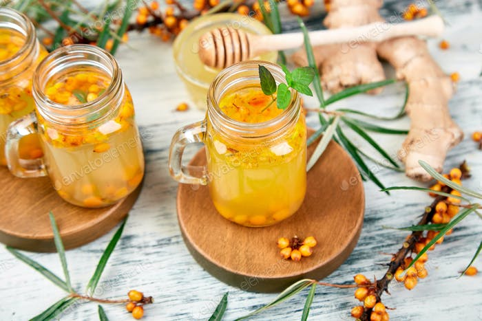 Hot sea buckthorn tea with ginger and honey