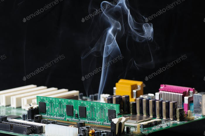 Thin stream of smoke is emitted from microcircuit