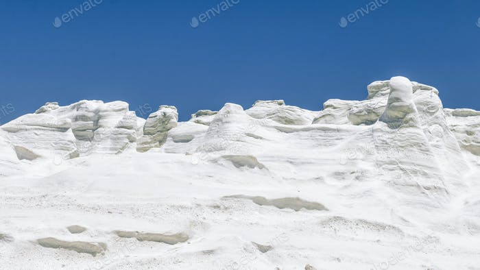 Milos Island Sarakiniko Volcanic White Stone Texture with Blue Sky