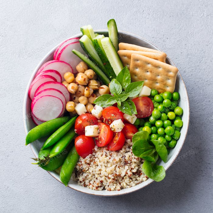 Healthy vegetarian salad. Buddha bowl. Grey Stone Background. Top View.
