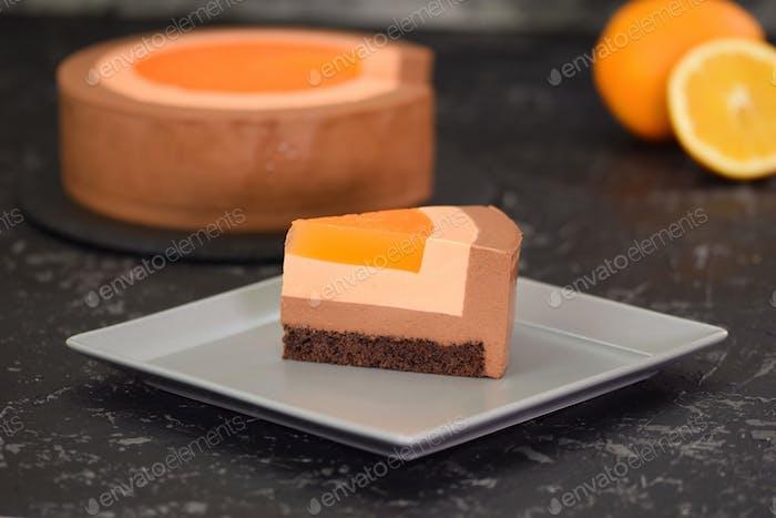 Piece of Orange Chocolate Mousse Cake. Sweet food.
