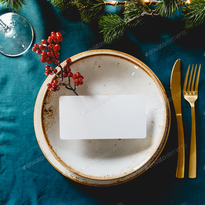 Festive table setting with winter decor and mockup