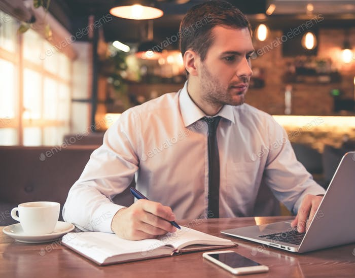 Attractive businessman in cafe