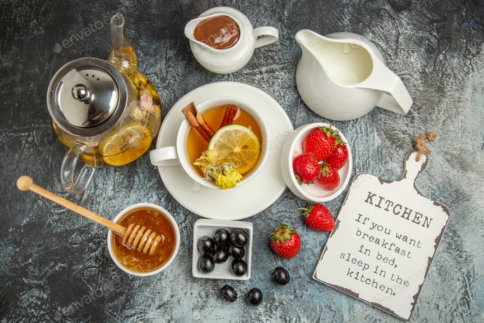 top view cup of tea with olives and honey on dark background morning breakfast food