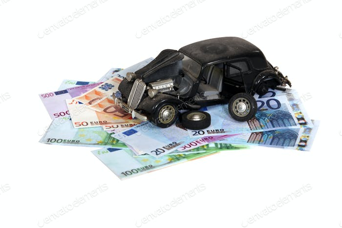 Model of an old car on a pile of banknotes