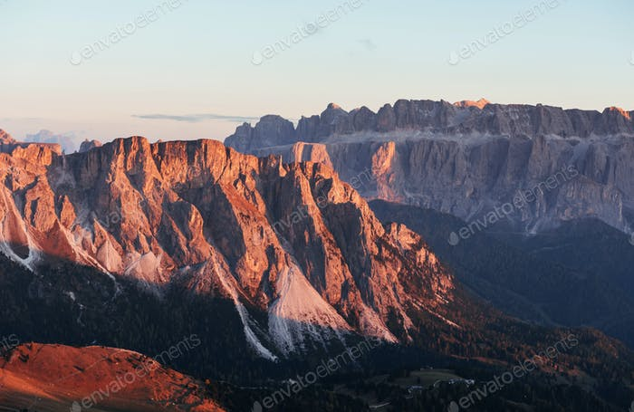 Orange hills. Landscape of mountains and trees below at sunny day. Italian Seceda alpes