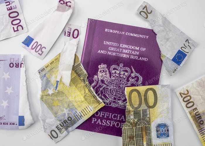 British passport next to broken euro notes, european union, brexit