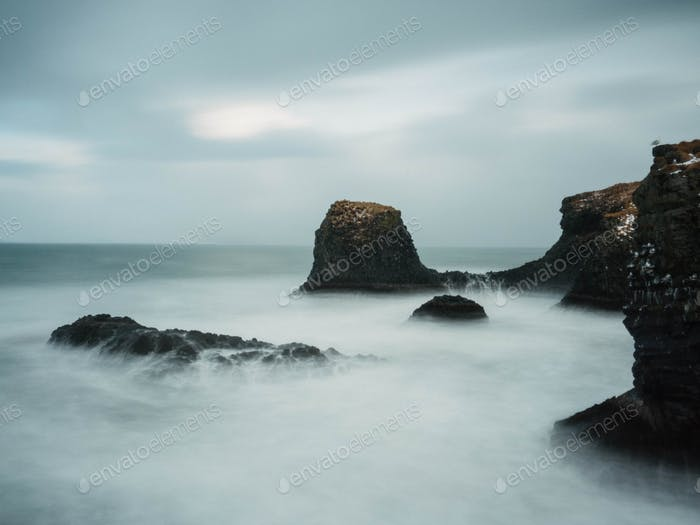 Water gushing over the rocks in a long exposure in iceland