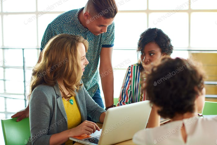 Candid image of a group with succesful business people caught in an animated brainstorming meeting