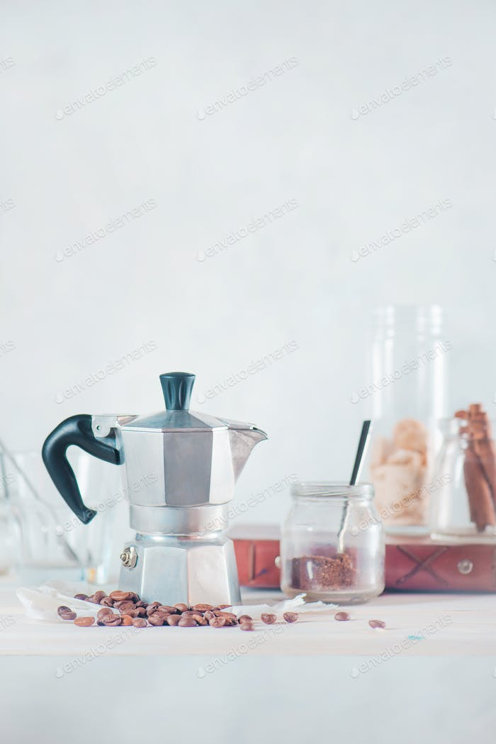 Creative barista concept. High key drink photography with Italian moka pot. Still life with coffee