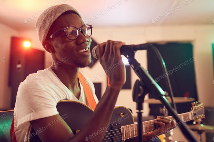 African Young Man Singing with Band
