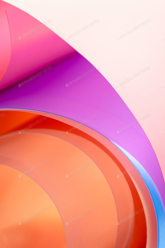 A close-up photo is a background of multicolored arcs with a gra