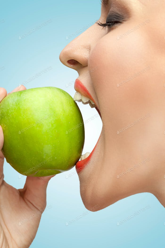 Biting apple.
