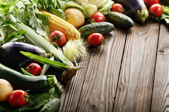 Fresh Organic Vegetable Food Ingredients on Wooden kitchen table
