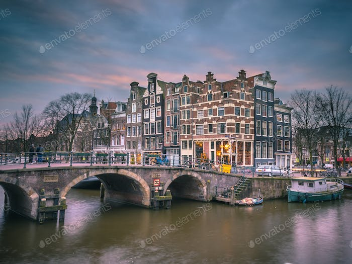 Canal houses sunset Amsterdam retro look