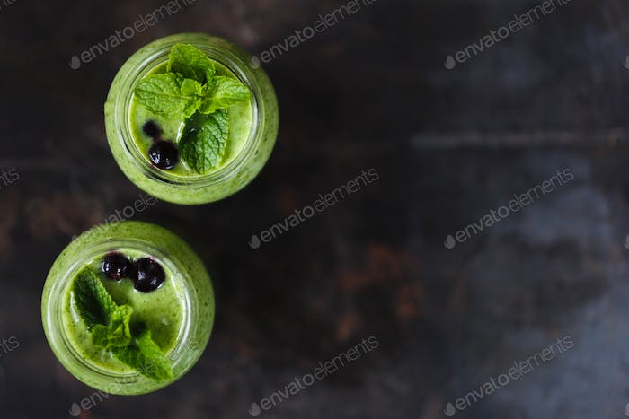 Two green smoothie in the jar