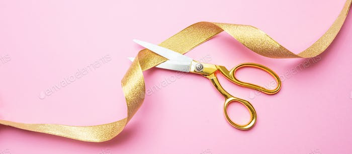 Grand opening. Gold scissors cutting golden ribbon, pink background, banner