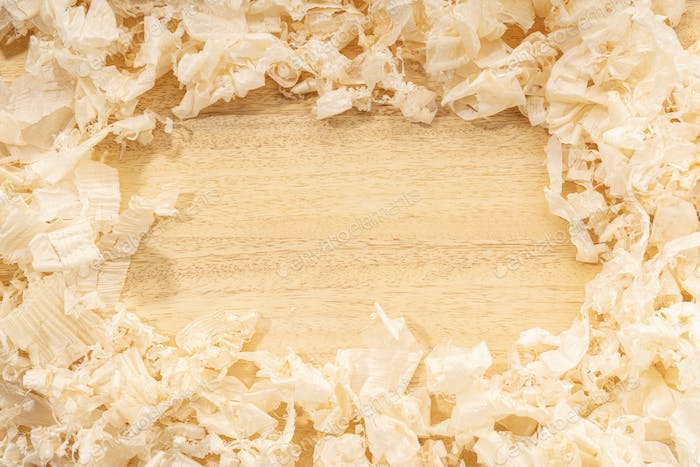 Border frame of wood shavings on wood table