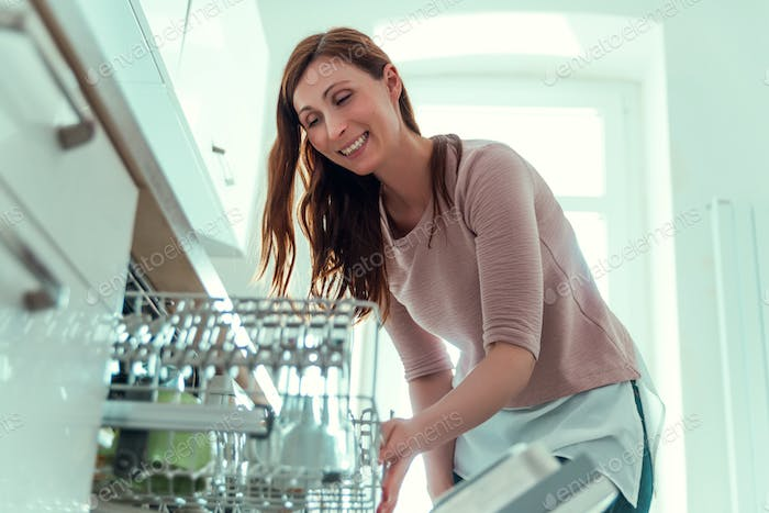 homework woman on dish washer