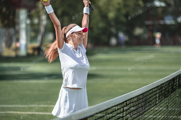 Happy woman on the court