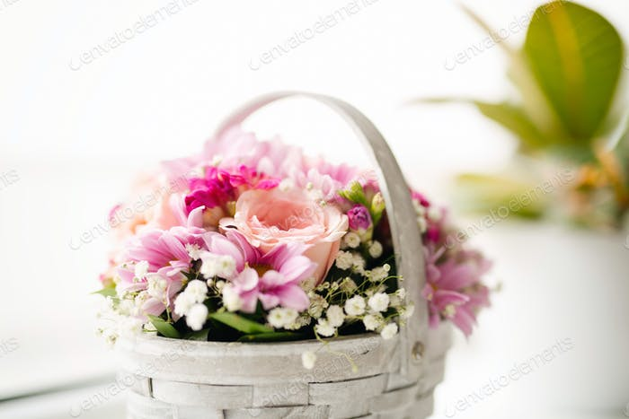Beautiful pink flowers in a basket, vintage style