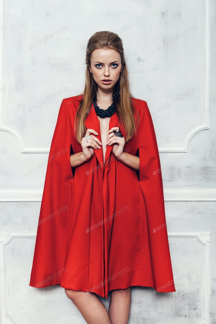 Fashion young beautiful woman in red coat