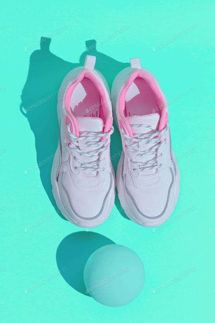 Minimal still life design. Fashion sport shoes concept. Pastel trends. Stylish white sneakers