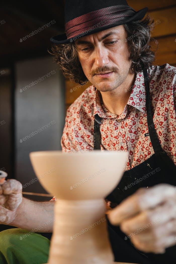 Potter master creating new ceramic bowl