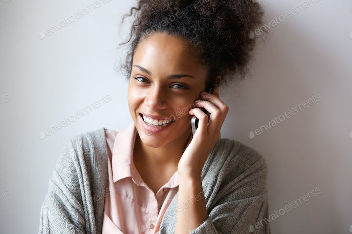 Young woman smiling and talking on mobile phone