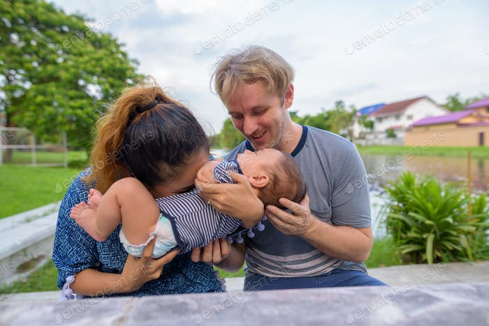 Multi-ethnic young family bonding together at the park