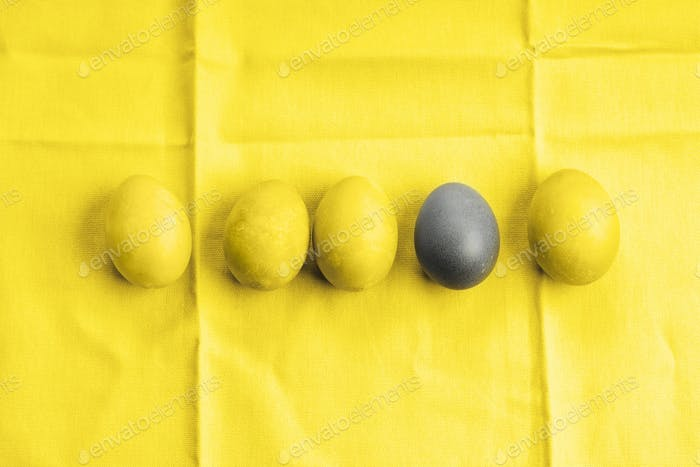Easter bright yellow and gray colored eggs