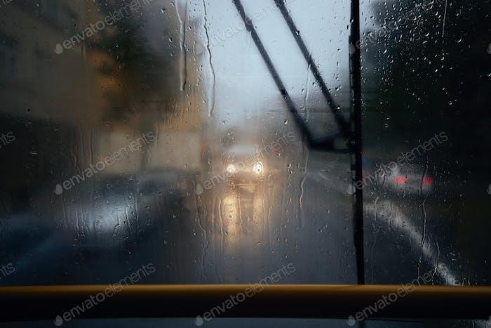 Traffic in city street during heavy rain