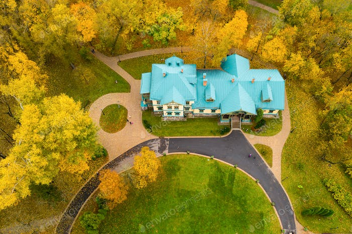 View from the height of the autumn loshitsky Park in Minsk and the manor Museum .Winding paths in