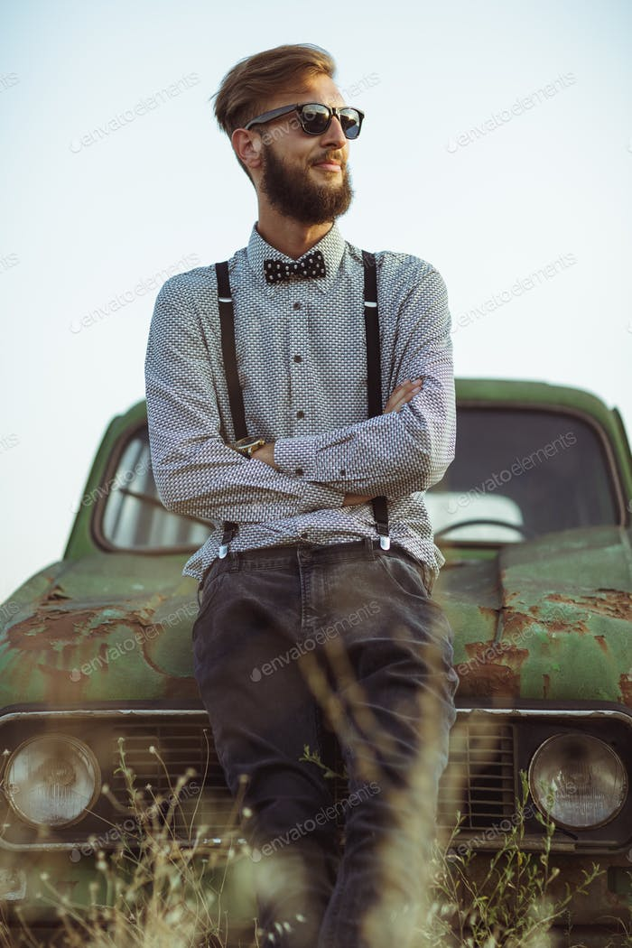 Young handsome stylish man, wearing shirt and bow-tie with old c