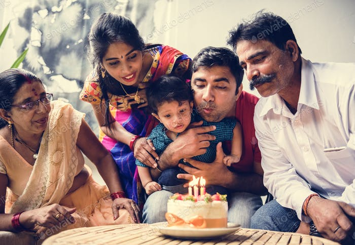 Indian family celebrating a birthday party
