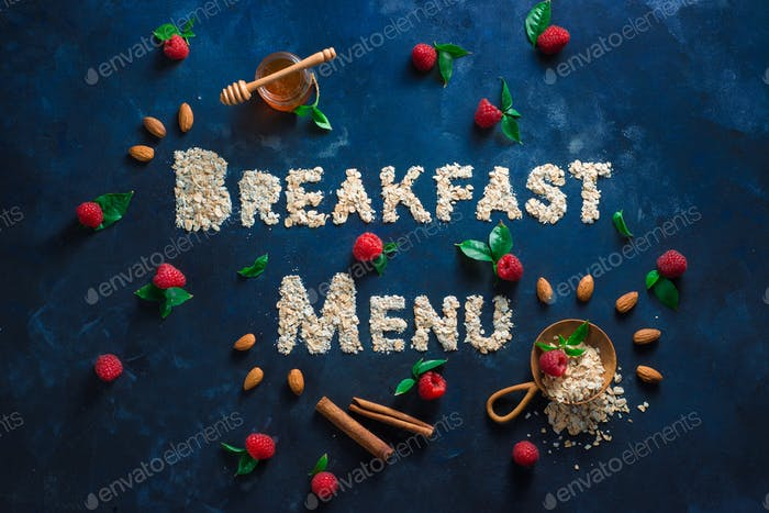 Breakfast menu header, words written with oatmeal. Healthy eating concept on a dark background with