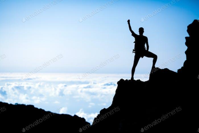Hiking success, man hiker runner climber in mountains