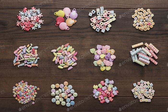 Different Colorful Beads On The Table
