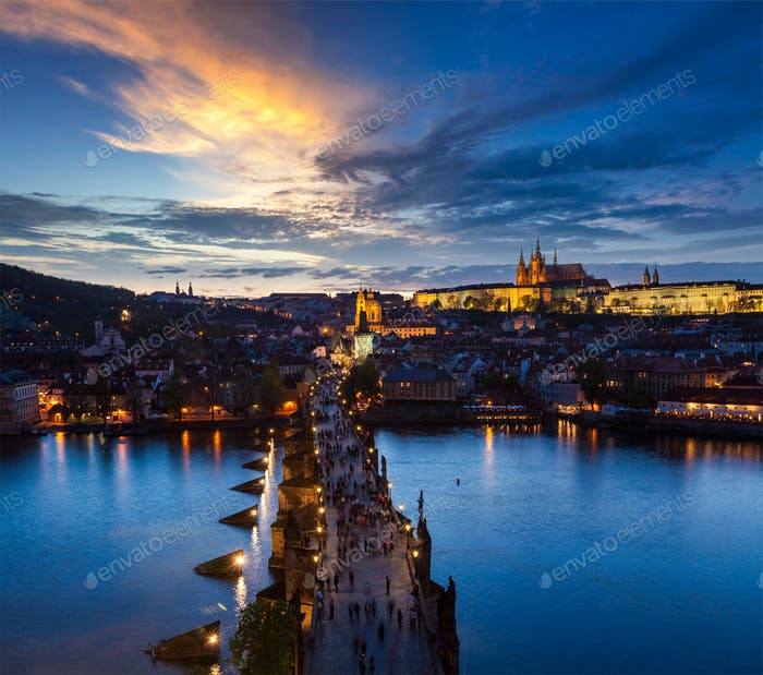 Night view of Prague castle and Charles Bridge over river
