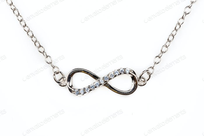 Silver infinity pendant with blue diamonds