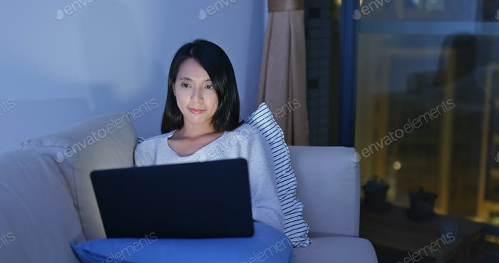 Woman work on laptop computer in the evening