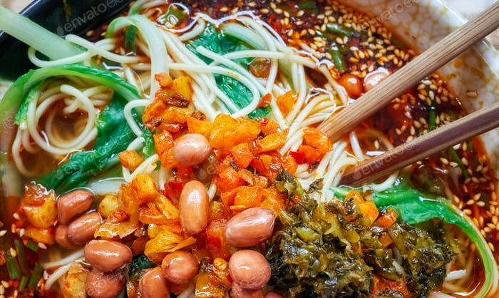 Spicy noodle soup popular in Yunnan Province, China.