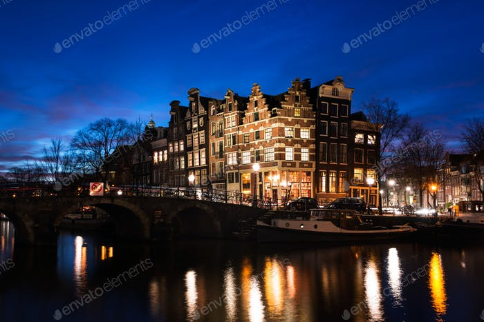 Amsterdam canal houses illuminated at dusk