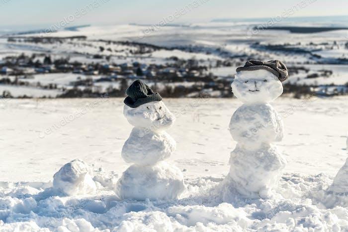 Snow men in a winter field