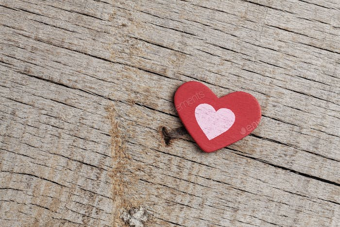 Red hearts on wooden