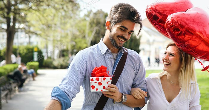 Man giving surprise gift as present to his lovely girlfriend