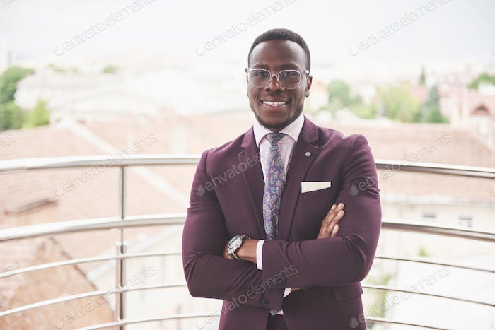 Happy smile of a successful African American businessman in a suit