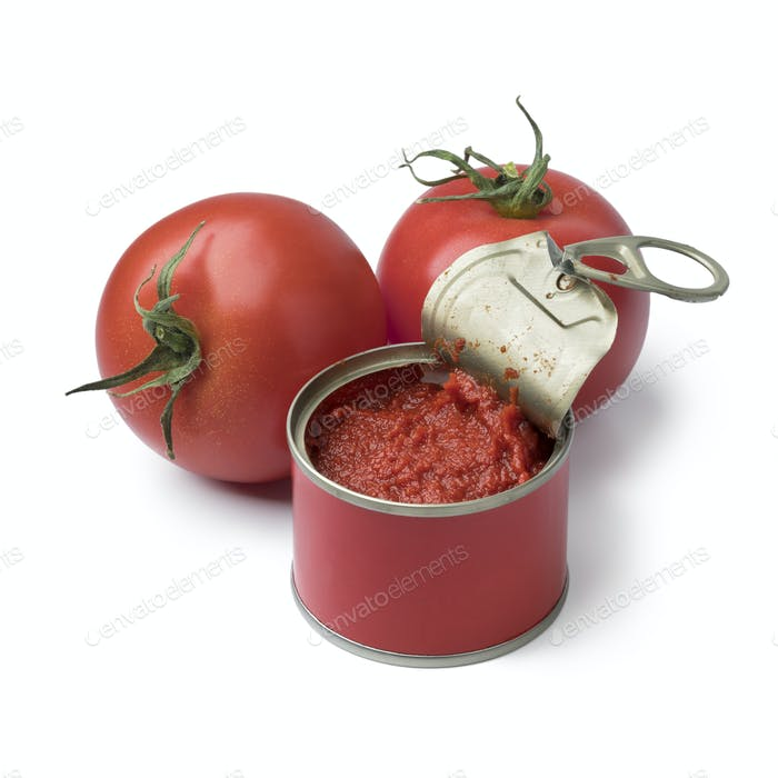 Open can with tomato paste and fresh tomatoes